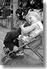 babies, black and white, california, childrens, emotions, girls, happy, hug, people, santa cruz, smiles, stroller, transportation, vertical, west coast, western usa, photograph
