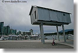 bicycles, bikes, canada, horizontal, houses, people, stilts, vancouver, photograph
