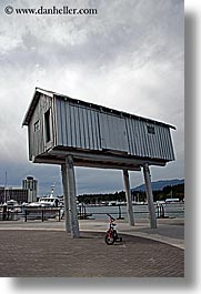 bicycles, bikes, canada, houses, people, stilts, vancouver, vertical, photograph