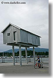 bicycles, bikes, boys, canada, childrens, houses, people, stilts, vancouver, vertical, photograph