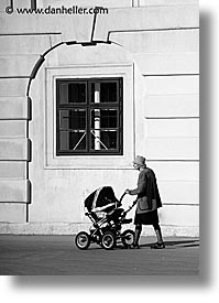 austria, black and white, buildings, europe, old, people, vertical, vienna, womens, photograph