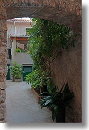arches, cres, croatia, europe, green, hangings, ivy, narrow streets, slow exposure, streets, vertical, photograph