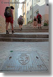 activities, covers, cres, croatia, europe, hikers, hiking, manholes, people, vertical, photograph