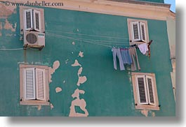 blues, buildings, colors, cres, croatia, europe, green, horizontal, jeans, laundry, photograph