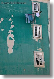 blues, buildings, colors, cres, croatia, europe, green, jeans, laundry, vertical, photograph