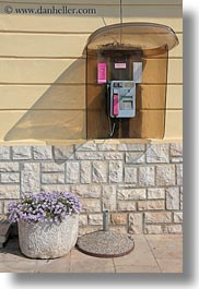 booths, cres, croatia, europe, plants, purple, telephones, vertical, photograph