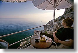 cafes, cliff cafe, croatia, dubrovnik, europe, horizontal, loungers, men, ocean, people, umbrellas, photograph