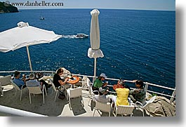 cafes, cliff cafe, cliffs, croatia, dubrovnik, europe, horizontal, ocean, people, umbrellas, photograph