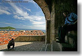 archways, cityscapes, croatia, dubrovnik, europe, horizontal, men, photographers, photographing, town view, photograph