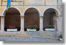 archways, cloisters, cobblestones, croatia, europe, flowers, groznjan, horizontal, materials, stones, structures, photograph