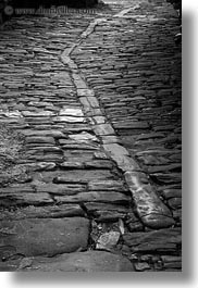black and white, cobble, cobblestones, croatia, europe, groznjan, materials, narrow streets, roads, stones, streets, vertical, photograph