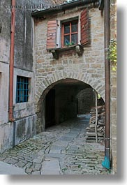 arches, archways, cobblestones, croatia, europe, groznjan, materials, narrow streets, roads, stones, streets, structures, vertical, windows, photograph