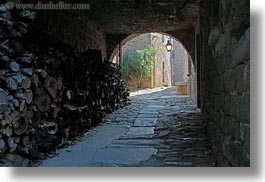 arches, archways, cobblestones, croatia, europe, groznjan, horizontal, materials, narrow streets, roads, stones, streets, structures, photograph