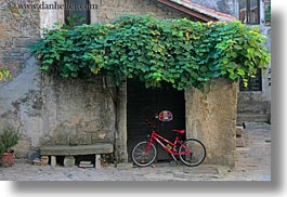 bicycles, croatia, europe, green, groznjan, horizontal, ivy, red, photograph
