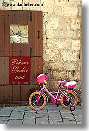 bicycles, croatia, doors, europe, girls, hvar, vertical, photograph