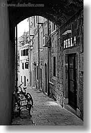 arches, archways, bicycles, black and white, croatia, europe, korcula, under, vertical, photograph