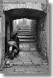 arches, archways, black and white, croatia, europe, korcula, motorcycles, stairs, under, vertical, photograph