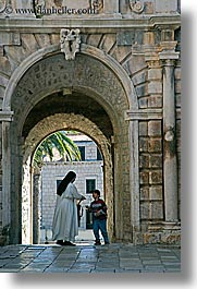 arches, archways, boys, childrens, croatia, europe, korcula, nuns, religious, sequence, vertical, womens, photograph