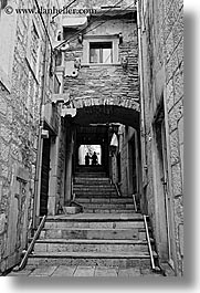 arches, archways, black and white, croatia, europe, korcula, people, silhouettes, stairs, under, vertical, photograph