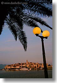 cityscapes, croatia, europe, korcula, lamp posts, palmtree, sunsets, vertical, water, photograph