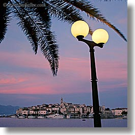 cityscapes, croatia, europe, korcula, lamp posts, palmtree, slow exposure, square format, sunsets, water, photograph
