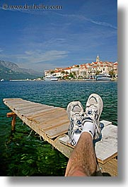 cityscapes, croatia, dock, europe, feet, korcula, townview, vertical, water, photograph