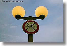 croatia, dogs, europe, horizontal, korcula, lamp posts, signs, swimming, photograph