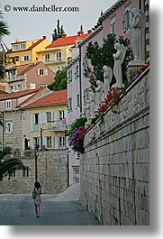 croatia, europe, korcula, statues, vertical, walking, womens, photograph