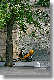 croatia, europe, korcula, motorcycles, trees, vertical, yellow, photograph