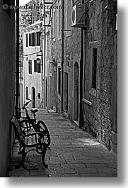 bicycles, black and white, croatia, europe, korcula, narrow streets, parked, vertical, photograph
