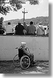 alone, black and white, croatia, europe, korcula, men, old, people, vertical, wheelchair, photograph