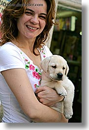 croatia, dogs, europe, girls, korcula, people, puppies, vertical, photograph