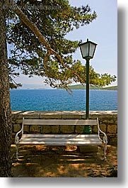 benches, croatia, europe, korcula, lamp posts, ocean, scenics, shade tree, vertical, photograph