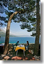 cafes, couples, croatia, europe, korcula, ocean, scenics, shade tree, vertical, viewing, photograph