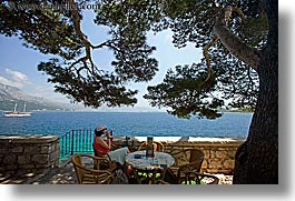 cafes, croatia, europe, horizontal, korcula, ocean, scenics, shade tree, viewing, womens, photograph