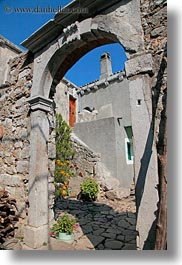 archways, croatia, doors, europe, flowers, lubenice, structures, vertical, photograph