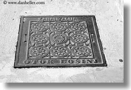 black and white, covers, croatia, europe, horizontal, losinj, mali losinj, manholes, photograph