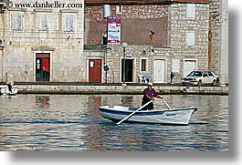 boats, croatia, europe, horizontal, men, milna, rowing, towns, water, photograph