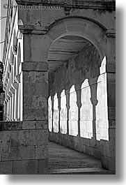 archways, black and white, buildings, cloisters, croatia, europe, milna, vertical, photograph
