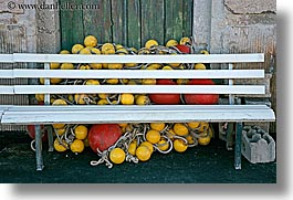 benches, croatia, europe, floaters, horizontal, milna, red, yelllow, photograph