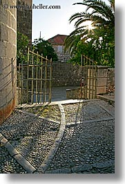 cobblestones, croatia, europe, gates, milna, sidewalks, vertical, photograph