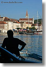 croatia, europe, men, milna, people, silhouettes, towns, vertical, water, photograph