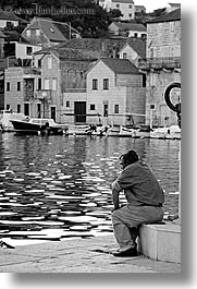 black and white, croatia, europe, men, milna, people, sitting, vertical, water, photograph