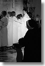black and white, boys, croatia, europe, milna, nuns, people, praying, religious, smiling, vertical, womens, photograph