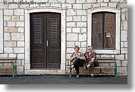 benches, buildings, croatia, dogs, doors, europe, horizontal, milna, people, windows, womens, photograph