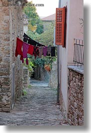 cobblestones, croatia, europe, hangings, laundry, materials, motovun, narrow, narrow streets, stones, streets, towns, vertical, photograph
