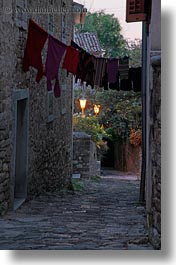 cobblestones, croatia, europe, glow, hangings, laundry, lights, materials, motovun, narrow, narrow streets, stones, streets, towns, vertical, photograph