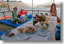 boats, couples, croatia, europe, foods, horizontal, lunch, nostalgija, tables, water, photograph