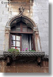 archways, croatia, europe, flowers, gothic, porec, structures, vertical, windows, photograph