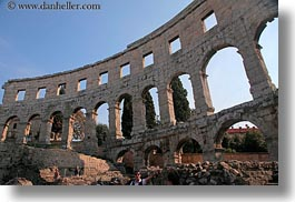 amphitheater, architectural ruins, archways, buildings, cloisters, croatia, europe, horizontal, pula, roman, structures, photograph